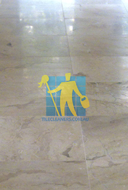 close shot of travertine tiles in large empty livingtoom large tiles after cleaning melbourne